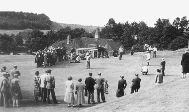 Exhibition match, June 1953. Alf Padgham and Sam King on the 18th green with our 4th clubhouse in the background.